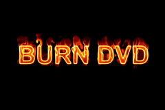 Burn DVD (Text serie). A fired word/phrase from a serie isolated on a black background Royalty Free Stock Photos