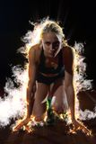 BURN FIRE  design of woman  sprinter leaving starting blocks Stock Photos