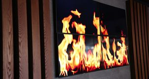 Burn The Fire Shown On The TV On The Wall. Wooden Wall. Close-Up. Prores, Slow Motion. 4k stock video footage