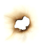 Burn hole in a piece of paper. Isolated over white Royalty Free Stock Image