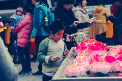 Burn incense and Chinese boy Royalty Free Stock Images