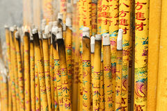 Burn incense. A chinese custom, people go to the temple to burn incense, pray god bless. write the meaning of the word is a blessing, lucky Royalty Free Stock Photo