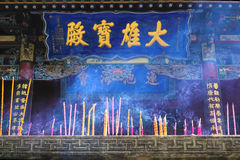 Burn incense and worship buddha. The joss sticks and candles are lit in front of main hall of Xuanzhong Temple in Jiaocheng, Shanxi, China Royalty Free Stock Photo