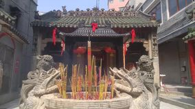 Shenzhen, China: burn incense and worship Buddha in the temple. Burn incense and worship Buddha in the temple. Xixiang beidi temple in shenzhen, China stock footage