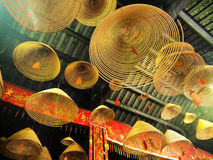 Burn joss sticks. A chinese temple and hanging circular joss-sticks stock photography