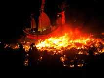 Burn the Lord ship. The lord bring the disaster to people,so people burned the ship for sending the king towards the sea Royalty Free Stock Images