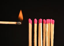 Burn match. Match burns in a black background Royalty Free Stock Image