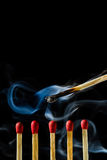 Burn match with smoke Royalty Free Stock Image