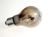 Burn-out broken light bulb Stock Image
