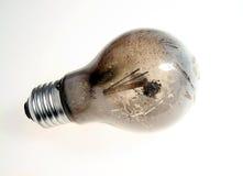 Burn-out broken light bulb Stock Image
