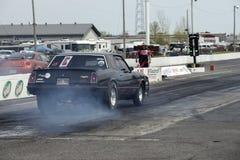 Burn-out de voiture d'entrave de Chevrolet photo stock