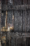 Burn out wood roof stock images