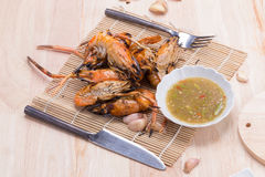Burn shrim and Seafood sauce on wooden table. Royalty Free Stock Photos