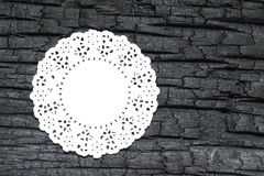 Burn Wood with white doily. Details patterned surface texture of burn wood Stock Photos