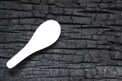 Burn Wood with white spoon. Details patterned surface texture of burn wood Royalty Free Stock Photography