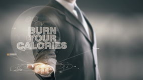 Burn Your Calories Businessman Holding in Hand New technologies. Businessman in the future with futuristic technology Royalty Free Stock Photography