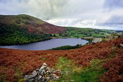 Cairn on Low Fell. Burnbank Fell and Waterend above Loweswater Royalty Free Stock Photos