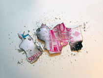 Burned. A burned 500 euro banknote. Clear but colored background stock image