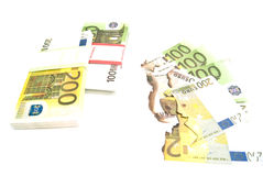 Burned banknotes and euros Stock Photo
