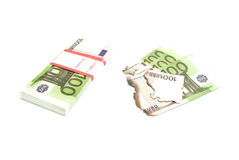 Burned banknotes and pack of euros on white Stock Image