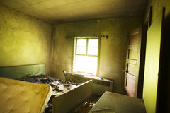 Burned Bed. In Abandoned Motel Room stock images