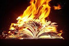 Burned book and fire. Burned book. The book is burning in fire royalty free stock image