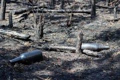 Burned bottles stock photography