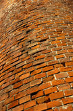 Burned brick. Close up of a curved brick wall. Old bricks. Suitable as background Stock Images