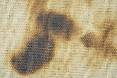 Burned canvas. Burnt edge of the fabric. Burned areas of the canvas- burn up surface stock photos