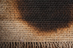 Burned canvas Stock Images
