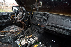 Burned car. Interior of a burned car royalty free stock photography
