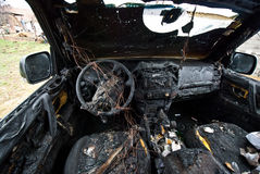 Burned car. Interior of a burned car stock image