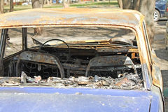 Burned car. A fully burned car in the street Royalty Free Stock Images