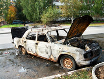 Burned car. Burned-out car parked on the street Stock Photography