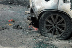 Burned car on accident site royalty free stock images