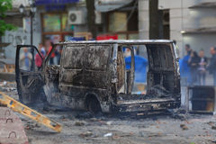 Burned car in the center of city after unrest Stock Photography