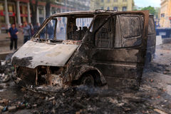 Burned car in the center of city after unrest Royalty Free Stock Photography