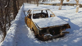 Burned car after a fire happened in winter park stock footage