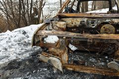 Burned car after a fire happened in winter park. Stock Image