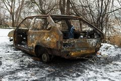 Burned car after a fire happened in winter park. Royalty Free Stock Photos