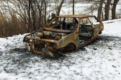 Burned car after a fire happened in winter park. Stock Images