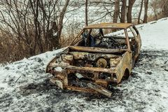 Burned car after a fire happened in winter park. Stock Photography