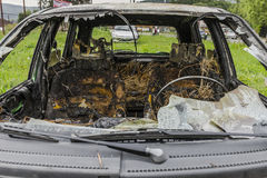 Burned car. Interior of a burned car . After the fire department show Royalty Free Stock Images