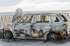 Burned Car Parked on the Street Stock Photography