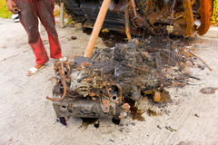 A burned car propped on its side in the caribbean Royalty Free Stock Images