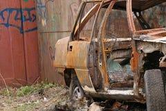 Burned car. Car burned after protests. Crime. Burned stolen car Stock Image