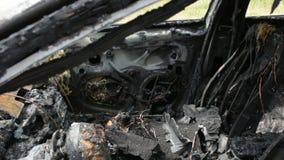 Burned car on the street stock footage