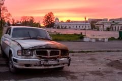 Burned car. On sunset background Stock Photos