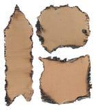 Burned cardboard Stock Images