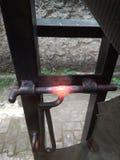 Burned Corrosive Black Iron Handle of Gate. Photo Burned Corrosive Black Iron Handle of Gate royalty free stock image